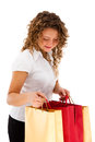 Young woman holding shopping bags portrait of attractive with isolated on white background Royalty Free Stock Photos