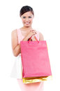 Young woman holding shopping bags portrait of a happy asian on white background Royalty Free Stock Photos