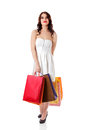 Young woman holding small empty shopping bags
