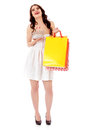 Young woman holding small empty shopping basket and shopping bags Royalty Free Stock Photo