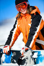 Young woman holding a snowboard Stock Photos