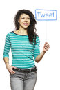 Young woman holding a social media sign smiling on white background Stock Photography
