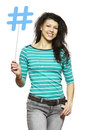 Young woman holding a social media sign smiling on white background Stock Photo