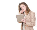 Young woman holding tablet pc and calling on the phone Royalty Free Stock Image