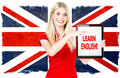 Young woman holding tablet pc english learning concept on the background with british national flag Royalty Free Stock Photo