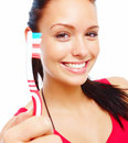Young woman holding toothbrush and smiling Stock Image