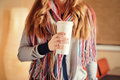 Young woman holding a tumbler of coffee in cafe Royalty Free Stock Photo