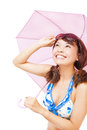 Young woman holding a umbrella and holding a glasses over white background Royalty Free Stock Images