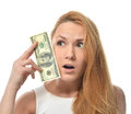 Young woman holding up cash money of one hundred dollars in hand Royalty Free Stock Photo