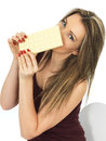 Young Woman Holding a White Chocolate Bar Royalty Free Stock Photo