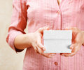 Young woman holding a white gift box Royalty Free Stock Image