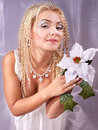 Young woman holding white  poinsettia Royalty Free Stock Image