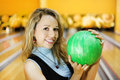 Young woman holds ball in bowling club Stock Image