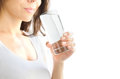 A young woman holds a glass of water in her hand and is about to drink it. White background. Copy Space Royalty Free Stock Photo