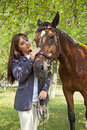 The young woman with a horse Royalty Free Stock Image
