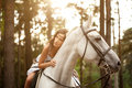 Young woman on a horse. Horseback rider, woman riding horse Royalty Free Stock Photo