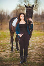 Young woman with a horse on nature this image has attached release Royalty Free Stock Photo