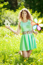 Young woman with hose model and key in a lush garden Stock Photo
