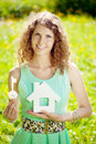 Young woman with hose model and key in a lush garden Royalty Free Stock Photo