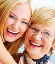 A young woman hugs an older happy elderly woman Royalty Free Stock Photos