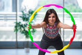 The young woman with hula loop in gym in health concept Royalty Free Stock Photo
