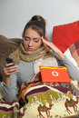 Young woman is ill in bed Stock Images