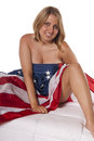 Young woman implied nude American Flag Stock Image
