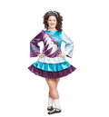 Young woman in irish dance dress posing isolated and wig Royalty Free Stock Photos