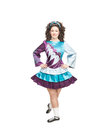 Young woman in irish dance dress posing isolated and wig Stock Photos