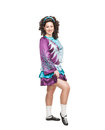 Young woman in irish dance dress posing isolated and wig Royalty Free Stock Photo