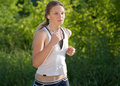 Young woman is jogging in the park Royalty Free Stock Photography