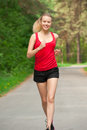 Young woman jogging in park Stock Image
