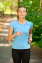 Young woman jogging in park Royalty Free Stock Images