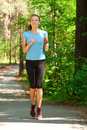 Young woman jogging in park Stock Images