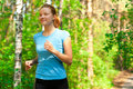 Young woman jogging in park Royalty Free Stock Photo