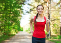 Young woman jogging in park Stock Photos