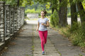 Young woman jogging in the park morning jog healthy lifestyle running Royalty Free Stock Photo