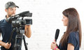 A young woman journalist  and a cameraman Royalty Free Stock Photo