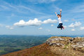 Young woman jumping on a background of mountains Royalty Free Stock Photo