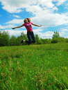 A young woman is jumping high Royalty Free Stock Photo