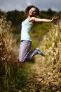 Young woman jumping of joy in the cornfield Royalty Free Stock Images