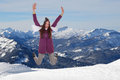 Young woman jumping for joy and happiness in mountains Royalty Free Stock Photo