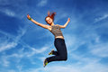 Young woman jumping on open air happy Stock Photos