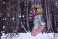 Young woman jumping in winter forest Royalty Free Stock Photo