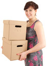 Young woman keeping cardboard boxes Royalty Free Stock Photo