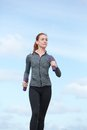 Young woman keeping fit by power walking Royalty Free Stock Photo