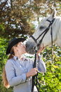 Young woman kissing a horse Royalty Free Stock Images