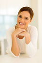 Young woman in kitchen smiling modern Stock Images