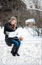Young woman knitting winter park Royalty Free Stock Photo