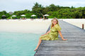 Young woman landing stage on beach on Maldives Royalty Free Stock Photography